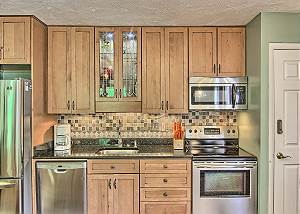 Gorgeous Kitchen with Full Size Appliances, Granite Counter Top, and New Cabinets.