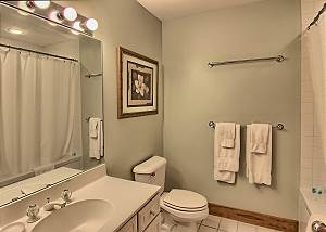 En Suite Bathroom for Master Bedroom with Combination Shower and Bath Tub.
