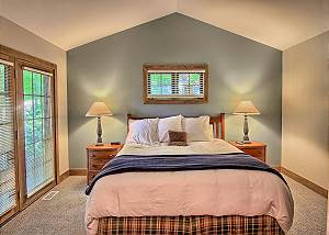 Master Bedroom with King Bed, Flat Screen TV, and En Suite Bathroom.