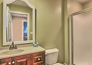 Bathroom on Main Level, Next to Second Bedroom, with Granite Counter, Slate Floor, and Full Shower.