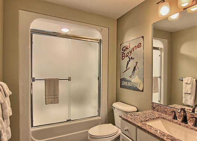 En Suite Bathroom for Third Bedroom with Granite Counter, Slate Floor, and a Combination Bath Tub and Full Shower.