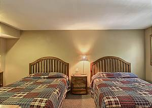 view of the third bedroom with two queen beds located in the loft