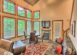 Spacious Living Room with Gas Fireplace, Queen Sofa Sleeper, Fireplace, Flat Screen Television, Ski Hill Views from the Wall of Windows, and Vaulted Ceilings.
