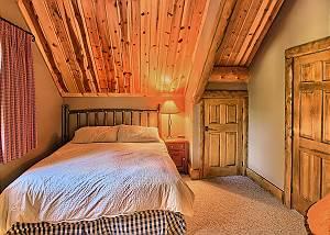 Master Bedroom with King Bed, TV,  and En Suite Bathroom.