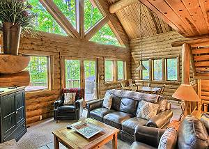 Spacious Living Room with Wood Burning Fireplace, Lots of Natural Light, and Queen Sofa Sleeper.