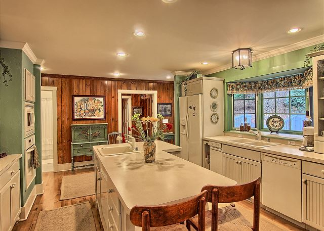 large kitchen that offers 2 dishwashers
