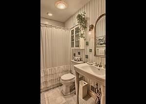 full bathroom located near the kitchen