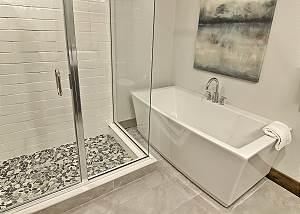 En Suite Master Bathroom with Custom Tiled Shower and Soaker Tub