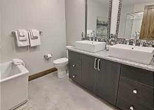 En Suite Master Bathroom with Custom Tiled Shower and Granite Countertops