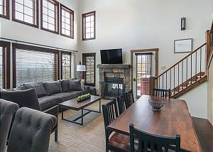 Expansive Living and Dining Area With Floor To Ceiling Windows.