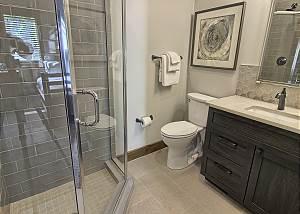 Main Level Bathroom with Custom Tiled Shower and Granite Countertops