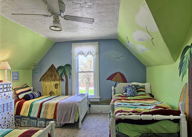 This great bright kids themed bedroom includes 3 twin beds
