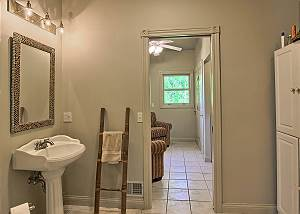 the downstairs bath has the laundry room just beyond the door as well as an outdoor exit to the deck.