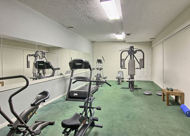 Weight machine, treadmill, stationary bike, and eliptical machine await you in our complimentary fitness room.