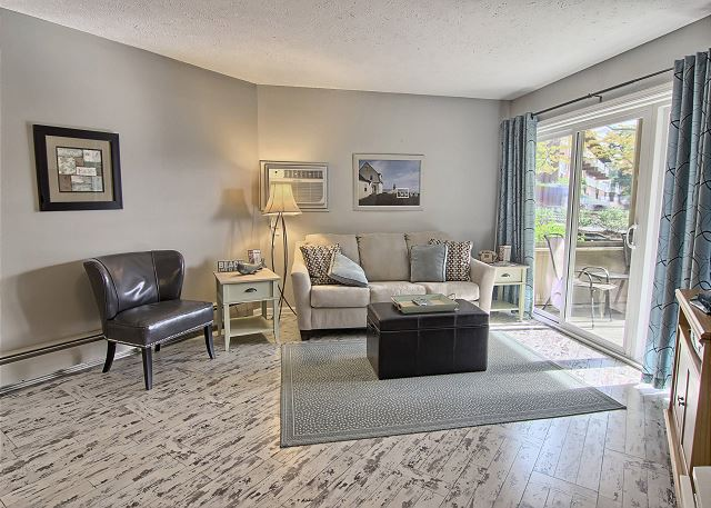 This gorgeous living room includes a comfortable sleeper sofa, cozy chair, TV with cable & DVD player & beautiful hardwood floors.