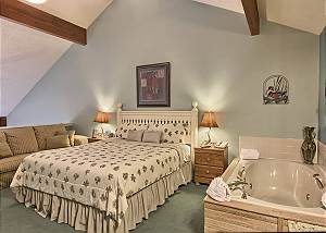 The loft bedroom includes a jetted jacuzzi tub, shower, vanity with lots of space and a separate area for the toilet