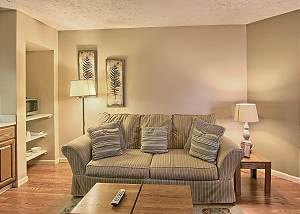 This cozy living room is perfect to relax in seated in a nice sized recliner or the love seat.