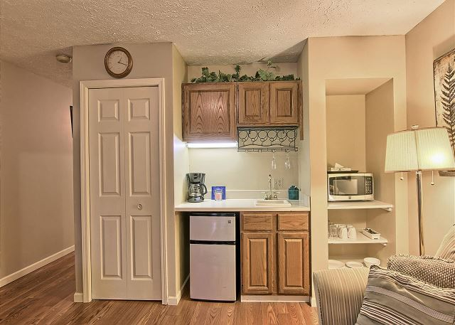 This kitchenette area is handicap accessible with easy access shelving for plates, cups and silverware. This area also includes small fridge, microwave, coffee maker, small sink and toaster.
