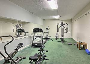 Weight machine, treadmill, stationary bike, and elliptical machine await you in our complimentary fitness room.