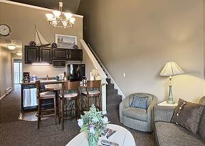 This living room includes sleeper sofa, cozy arm chair, electric fireplace, Tv with DVD player