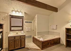 The loft bedroom includes a jetted jacuzzi tub, shower, vanity with lots of space and a separate area for the toilet.
