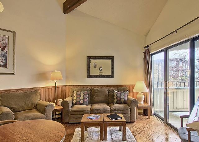 This cozy living room is perfect to relax on the couch or in one of the side chairs. You can enjoy a movie on the TV or just cozy up in front of the electric fireplace.  Just beyond that is the walk-out screened in porch.