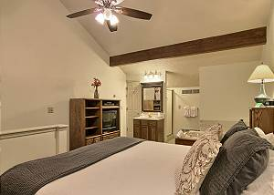 The bedroom  has a comfortable king sized bed, two bedside tables, a dresser, closet and TV with cable