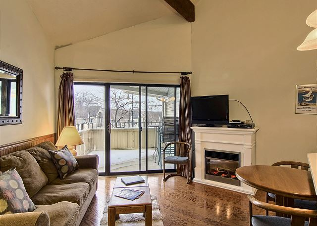 The queen-sized sleeper sofa is in the living room along with a separate chair. Also a flat screen tv with cable & DVD player. Off the living room is the walk-out screened in patio with seating for two.