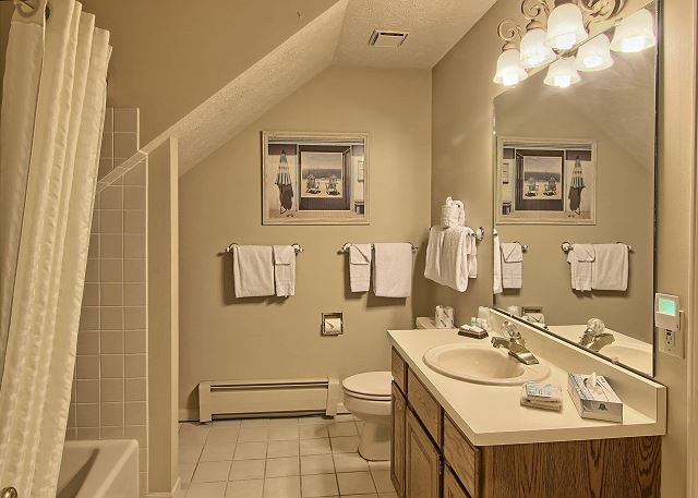Granite countertops surround the vanity; towels and hairdryers provided