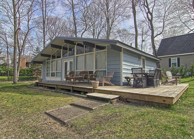 Exterior of Home with Spacious Deck and Outdoor Eating Area