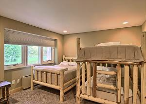 view of third bedroom with queen bunkbeds and a queen stand alone bed