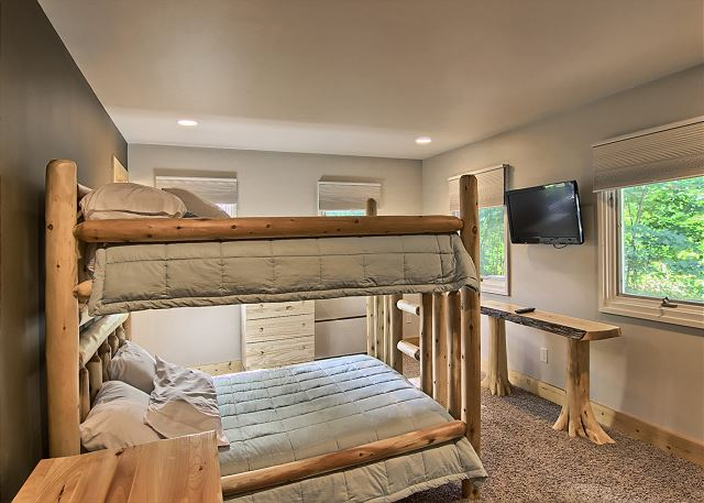 View of second bedroom with queen bunkbeds