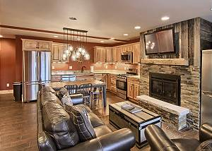 Picture of when you first walk into the condo and see the beautiful living room and dinning room areas with a view of the fireplace