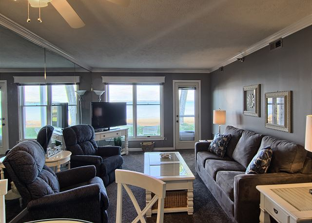 Walkout to the beachfront from this living room