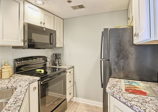 Beautiful updated kitchen, with newer appliances and granite countertops