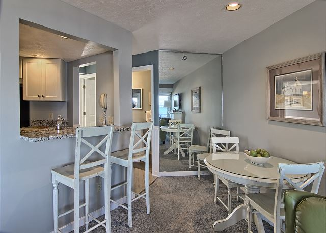 Granite countertop in the kitchen provides an excellent breakfast nook for two