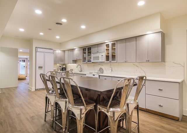 2nd kitchen and island located in the lower level with seating for 7