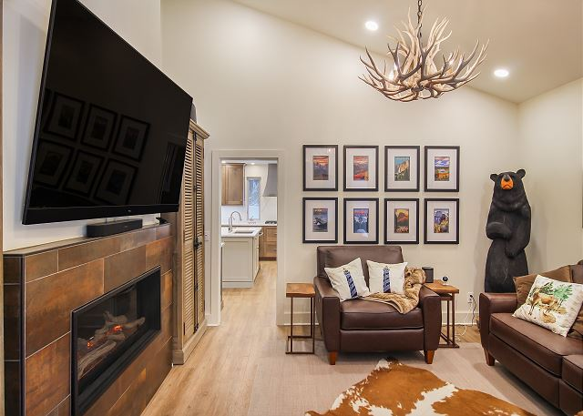 This Den area is complete with a big screen smart TV, gas fireplace and 2 leather chairs and leather couch that with a push of a button turn into full length recliners