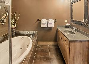 En suite full bathroom in master suite