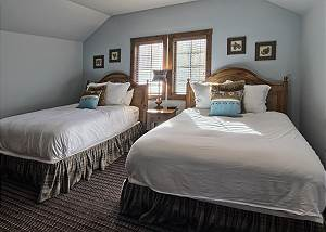 Fourth bedroom on second level provides two queen beds