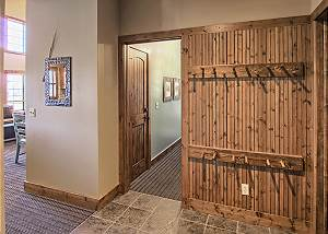 Custom coat racks in entry way perfect for ski/snow gear