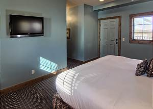 Master Bedroom with mounted flat screen tv