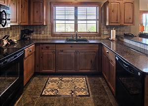 Granite countertops and beautiful wood cabinets in kitchen