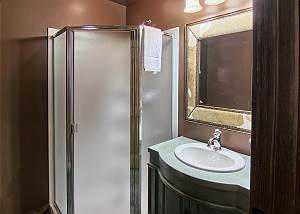 Main level hosts a second full bathroom with shower