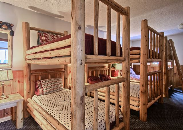 This great bunk room has 3 sets of bunk beds. One set of twin bunks and 2 Queen bunk beds.