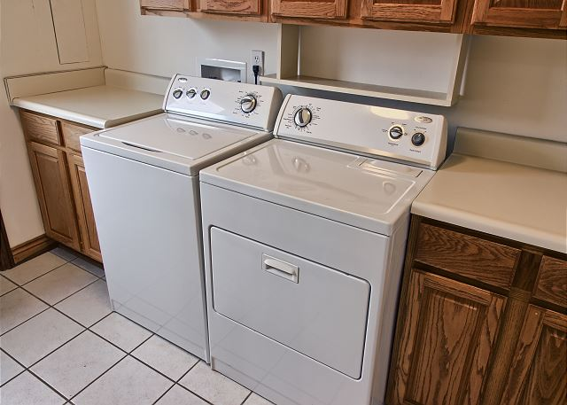 Laundry room located off of the Kitchen with exterior door