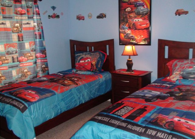 "Third Bedroom with a lovely kids room with Disney Character ""CARS"" decoration and has 2 twin beds, closet and flat screen cable tv"