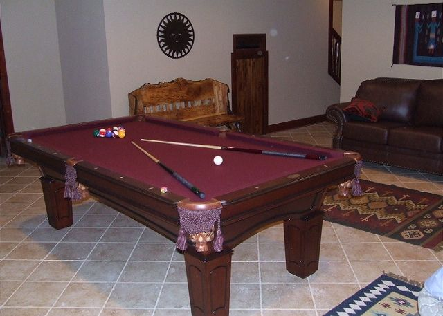 enjoy a game of pool on the regulation size pool table downstairs in the family room adjacent to the theatre room