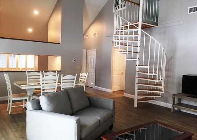 Open concept living and dining spaces