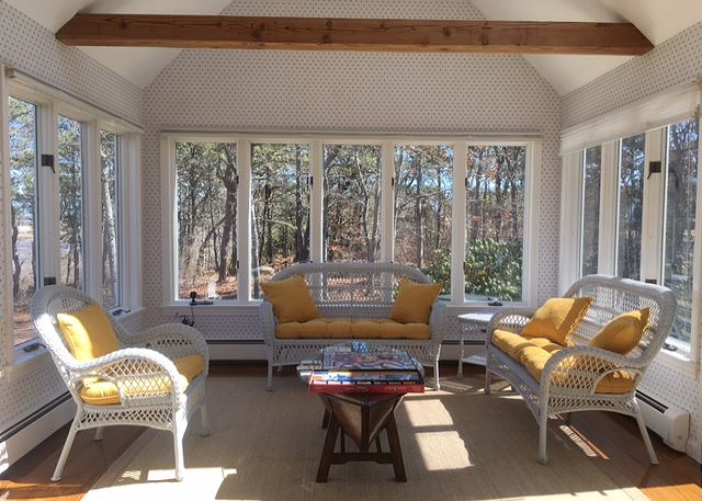 Sunroom with exposed wood beams